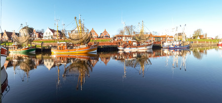 Greetsiel, Germany - December 6, 2014: Tourist city to the North Sea with a small port. There are several boats moored typical for fishing.