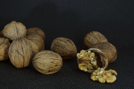 Delicious kernel of walnut on a chopped shell. Around whole nuts