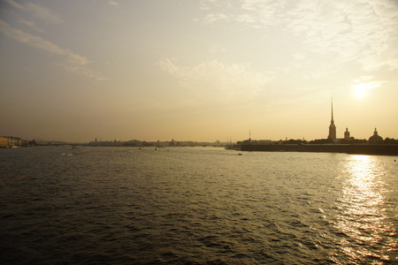 Silhouette at sunset, Peter and Paul Fortress, landmark in St. Petersburg.