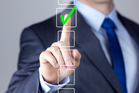 Foto de Businessman making right decision touching screen interface - Imagen libre de derechos