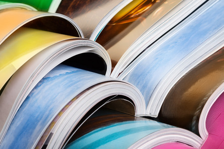 Foto de Close-up of stack of colorful magazines. Press, news and magazines concept - Imagen libre de derechos