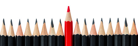 Photo for One red pencil standing out from the row of black pencils. Letter box format - Royalty Free Image