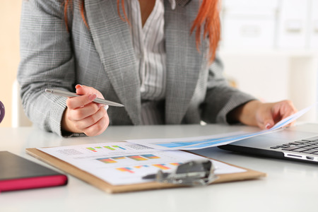 Photo pour Businesswoman looking at graphics. Manager or auditor reading reports. Financial planning, business analysis and project management concept. - image libre de droit
