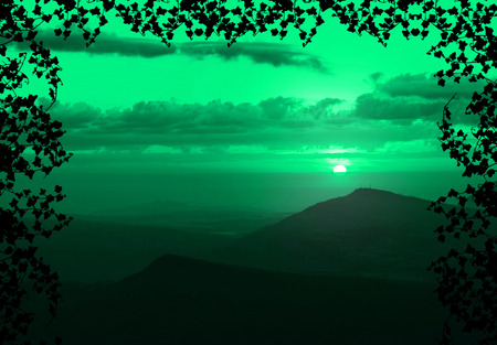 Beautiful sunset with cloud and mountain,tree foreground siluette frame,green color tone