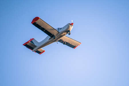 Photo for small single seater plane flying in the blue sky - Royalty Free Image