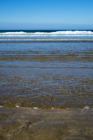 calm soft waves lashing onto ballybunion beach in county kerry ireland