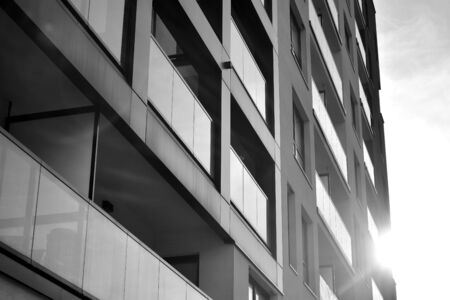 Photo pour Detail of modern residential flat apartment building exterior. Fragment of new luxury house and home complex. Black and white. - image libre de droit