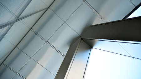 Photo pour Combination of metal and glass wall material. Steel facade on columns. Abstract modern architecture. High-tech minimalist office building. Contemporary business architecture abstract fragment. - image libre de droit