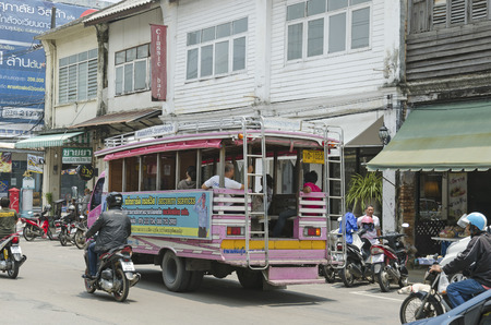 City bus on the streets of the old town. Phuket Town, Thailand