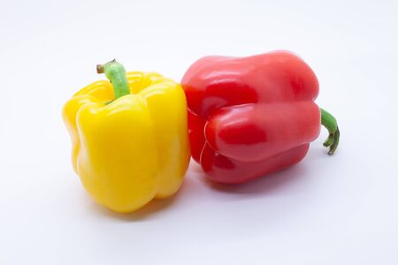 Photo for Red and yellow sweet bell pepper on a white background, selective focus - Royalty Free Image