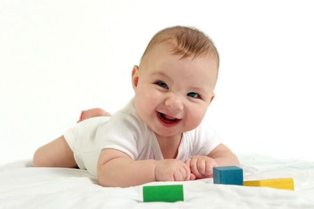 Photo pour Happy baby smiling at camera, playing with blocks - image libre de droit