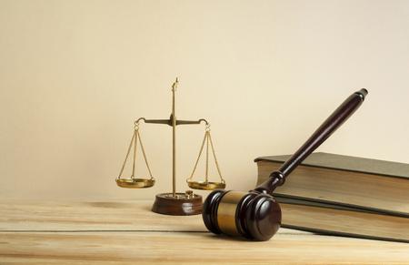Foto de Law concept. Wooden judge gavel,scales of justice and books on table in a courtroom or enforcement office. - Imagen libre de derechos