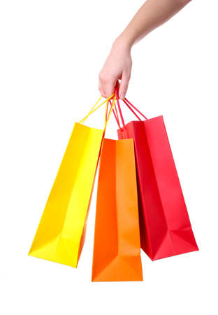 Photo for Hand holding colorful paper bags isolated on white background shopping concept - Royalty Free Image