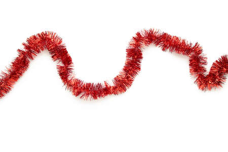 Photo pour Christmas red tinsel isolated on white background. Top view. - image libre de droit