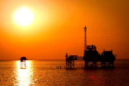 Photo for Oil rig in the sunset - Royalty Free Image