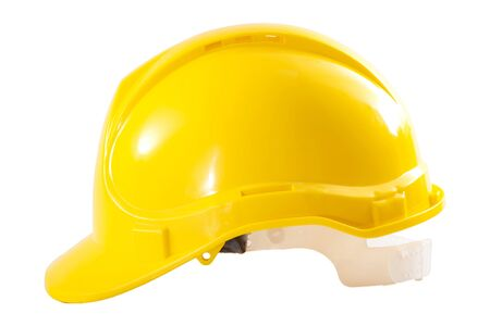 Photo pour Industrial workers or construction site safety equipment concept with side view of a yellow hard hat isolated on white background with a clipping path cutout - image libre de droit