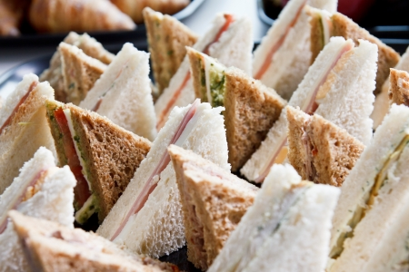 Cut platter of mixed  sandwich triangles