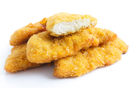 Golden fried chicken strips on white.