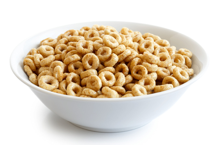 Bowl of honey cheerios isolated on white.