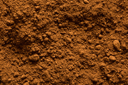 Photo pour Background of ground cocoa powder from above. - image libre de droit