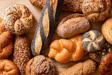 Foto für Background of mixed baguettes and bread rolls on light wood. Top view. - Lizenzfreies Bild
