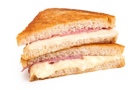 Photo pour Classic cheese and ham toasted sandwich cut in half isolated on white. - image libre de droit