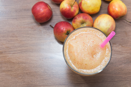 close up of apple smoothie on glass