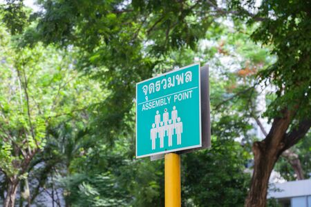emergency green assembly point sign translate in Thai