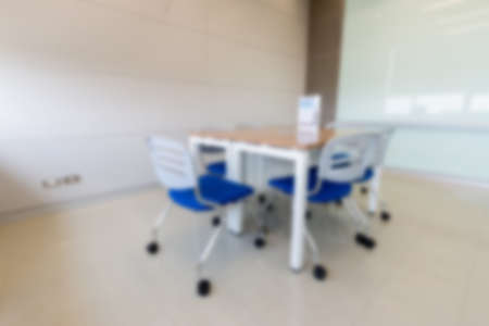 Photo pour Blurry abstract background of empty modern boardroom, meeting office room - image libre de droit