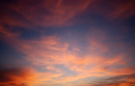 Background of a cloudscape in red color