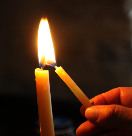 Photo for Human hand holding and lighting the candle in church for pray and make a wish. - Royalty Free Image