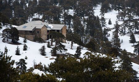 Photo for Idyllic abandoned mountain chalet   at the forest of Troodos mountains in Cyprus during winter after a heavy snow. - Royalty Free Image