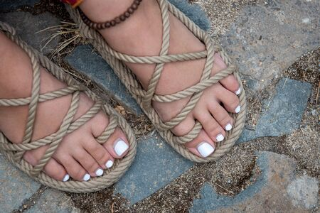 Foto de Beautiful and white polished toenails of a young teenage girl. - Imagen libre de derechos