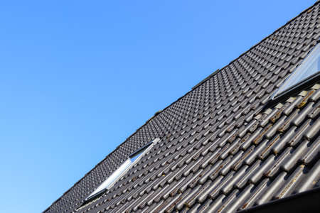 Photo for Roof window in velux style with black roof tiles - Royalty Free Image