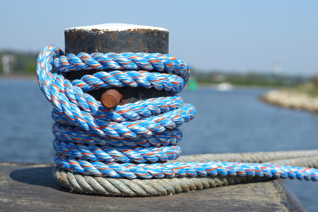 Photo for Blue rope around a bollard at a quay - Royalty Free Image