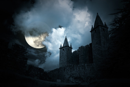 Mysterious medieval castle in a full moon night