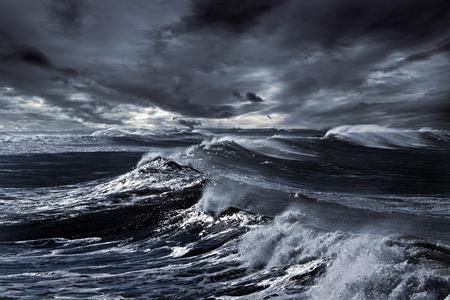 Storm in ocean with big windy waves; Northeast Atlantic Coast; enhanced sky; toned blue