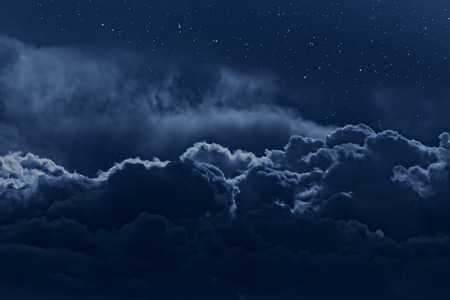 Photo pour Night sky with stars and strong clouds as seen from above - image libre de droit