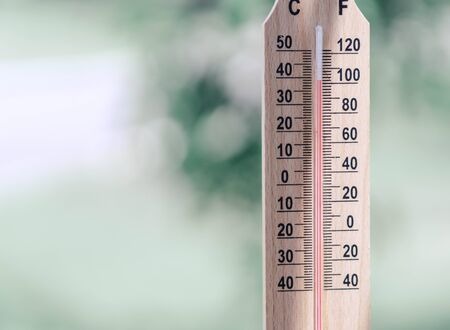 Photo for Close up hand holding thermometer with hot temperature - Royalty Free Image