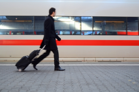 Motion Blur Of A Man Rushing To Catch A Train At A Station