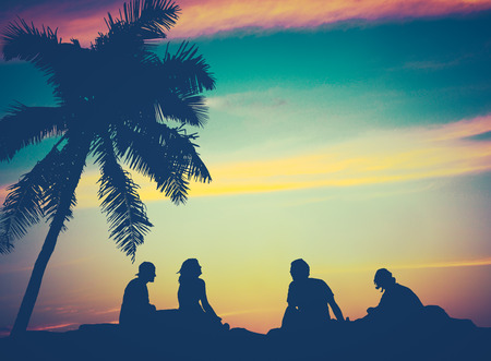 Retro Filtered Image Of Friends By The Beach in Hawaii