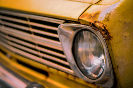 Retro Filter Photo Of A Damaged Vintage Seventies Car