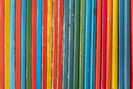 Foto de Abstract Background Of Colourful Old Vintage Children's Books On A Shelf - Imagen libre de derechos