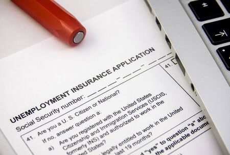 Photo for An Unemplyment Insurance Application Form Being Filled Out Due To The Coronavirus Pandemic - Royalty Free Image