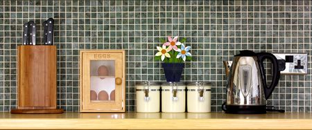 Luxury Kitchen worktop with kitchen items and a tiled wall