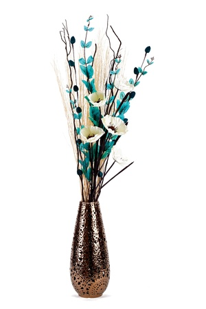 Tall stylish flower arrangement in a vase isolated