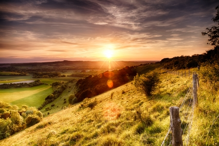 Hill fence landscape with evening sunset