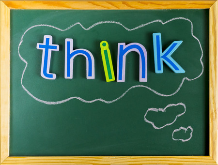 Think positive or negative, colorful words on blackboard
