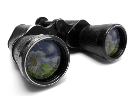 Photo of old binoculars, isolated on a white background