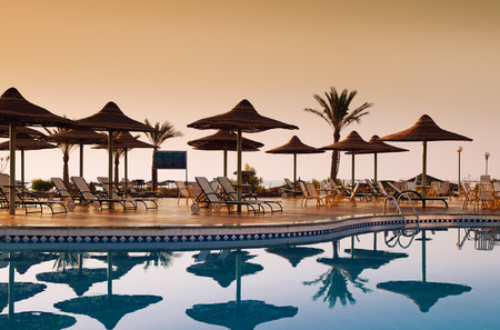 Swimming pool with palm trees at morning. Hurghada. Egypt